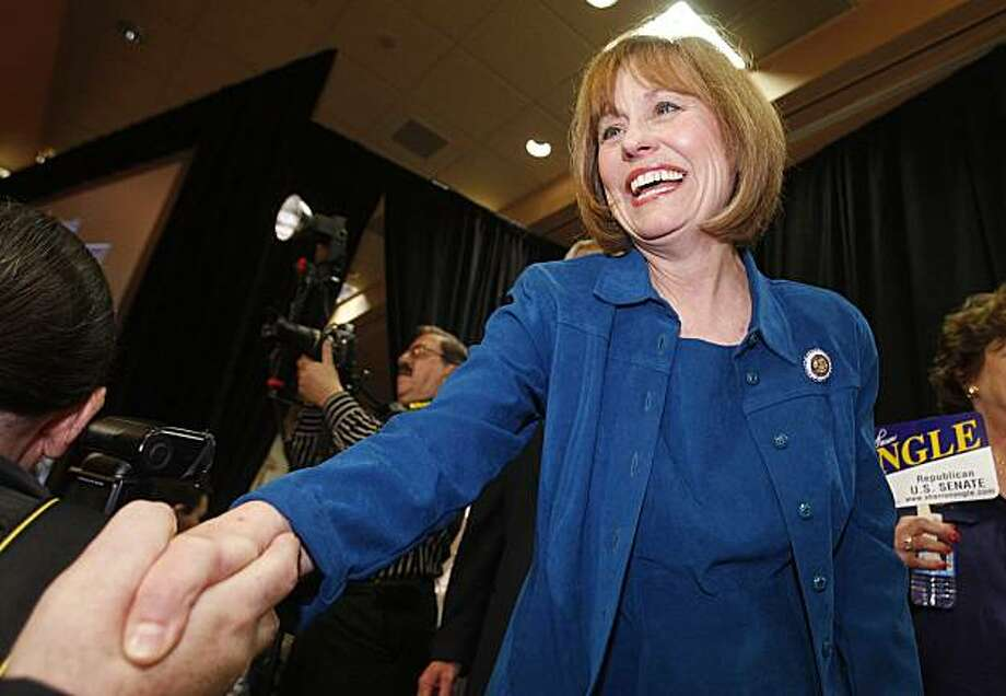 Sharron Angle shakes hands of supporters after winning the Nevada Republican U.S. Senate primary election race Tuesday, June 8, 2010 in Las Vegas. Angle will face Sen. Harry Reid, D-Nev. in November. Photo: Isaac Brekken, AP