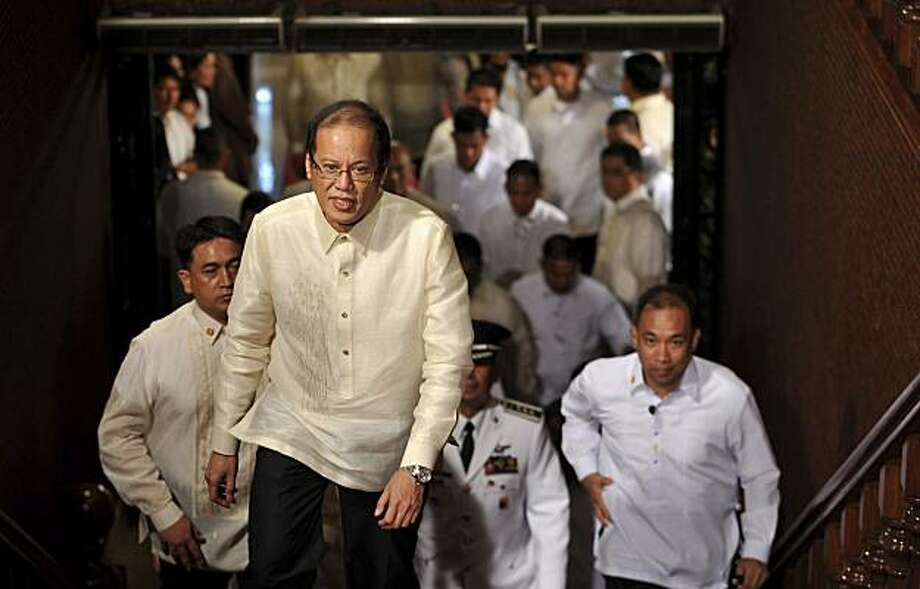 New Philippine President Benigno Aquino III ascends a flight of stairs upon entering the presidential palace in Manila, Philippines, Wednesday, June 30, 2010. Aquino was sworn in Wednesday as the Philippines' 15th president, leading a Southeast Asian nation his late parents helped liberate from dictatorship and which he promises to deliver from poverty and pervasive corruption. Photo: Noel Celis, AP