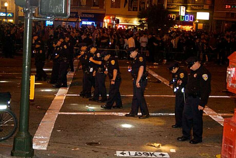 Police officers are looking for evidence on Market Street in the Castro after a shooting in San Francisco, Calif. on June 27, 2010. Photo: Matt Baume, Special To The Chronicle