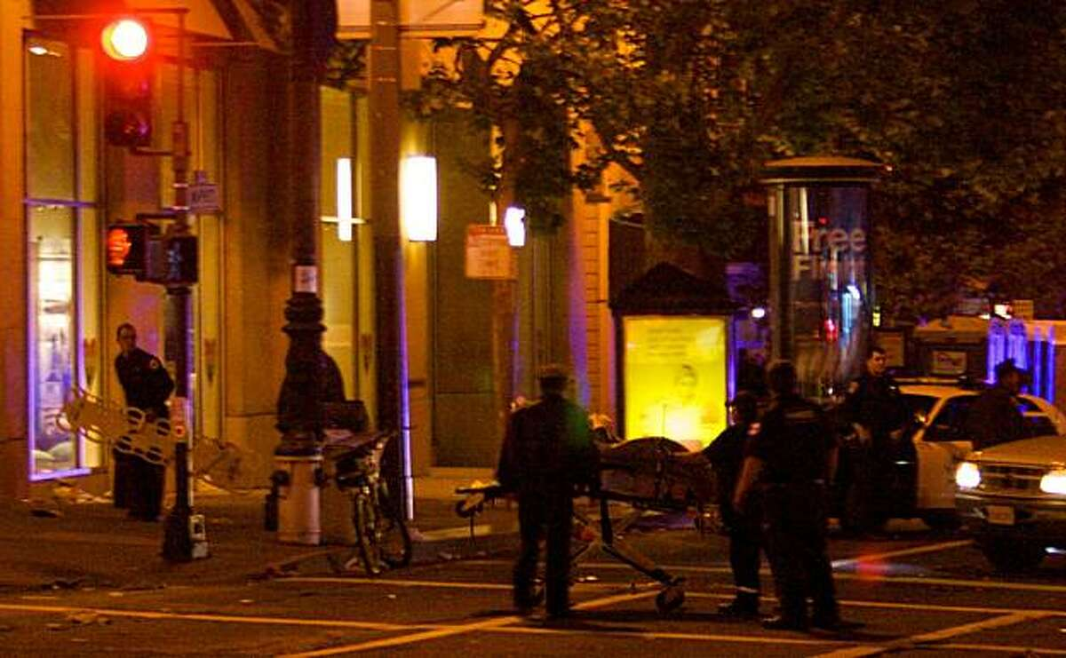 Shooting victim is moved down Market Street in the Castro by police on Saturday, June 26, 2010 in San Francisco, Calif.