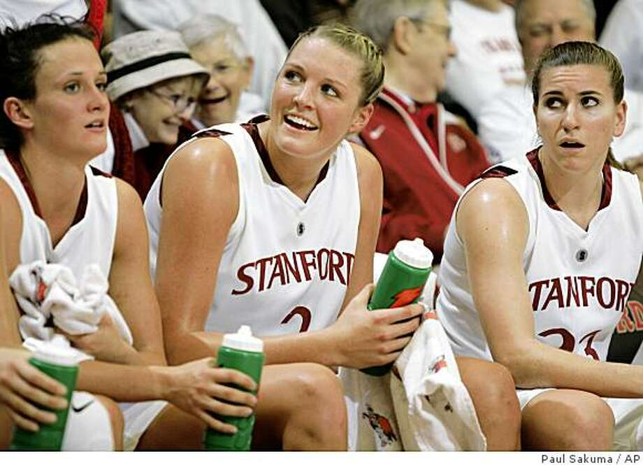 Stanford center Jayne Appel, center, smiles on the bench in the final minutes of the second half  against Rutgers in Stanford, Calif., Sunday, Nov. 23, 2008. Appel was game high scorer with 19 points. Stanford upset Rutgers 81-47. Photo: Paul Sakuma, AP