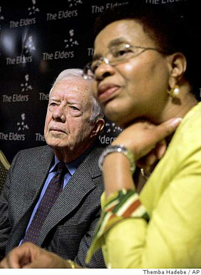 """Internationally renowned rights activist and wife of Nelson Mandela, Graca Machel, right, and former US president Jimmy Carter, left, take questions during a media conference in Johannesburg, South Africa, Monday Nov. 24, 2008. Kofi Annan, Jimmy Carter and Graca Machel say Zimbabwe's leaders do not know or do not care about the """"deep suffering"""" caused by the country's crisis and call for Southern African leaders to take decisive action to halt it. Speaking as The Elders, a group of statesmen and humanitarian advocates, they welcome South Africa's harder stance and withholding of agricultural aid until Zimbabwe's rival political parties form a power-sharing government. (AP Photo/Themba Hadebe) Photo: Themba Hadebe, AP"""