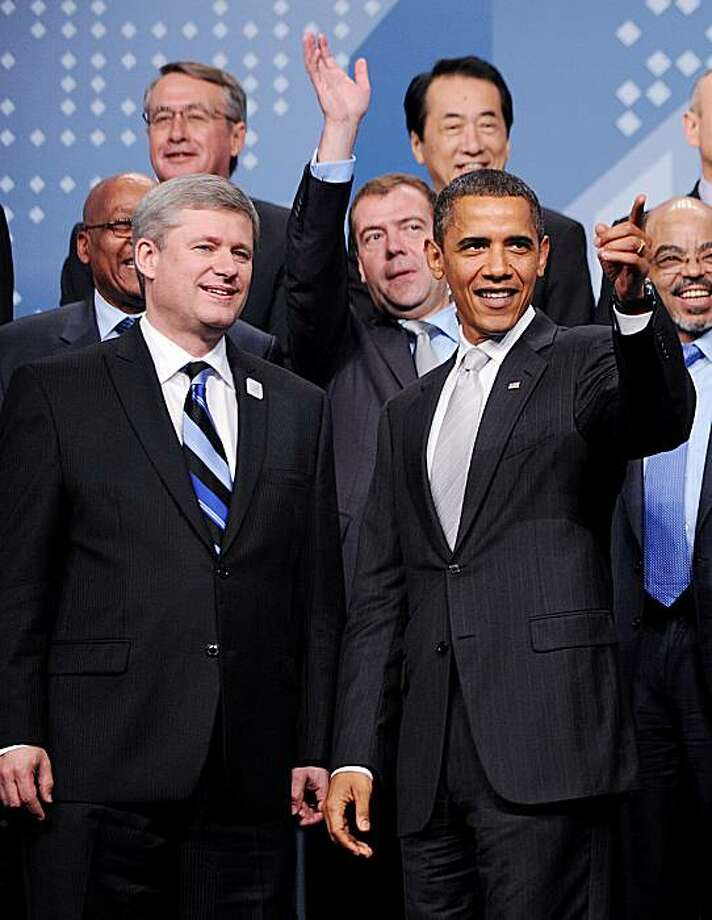 Leaders from around the world including, U.S. President Barack Obama, right, and Canadian Prime Minister Stephen Harper pose for a G20 Summit photograph at the Convention Center in Toronto, Ontario, Canada, Sunday, June 27, 2010. (Olivier Douliery/Abaca Press/MCT) Photo: Olivier Douliery, MCT