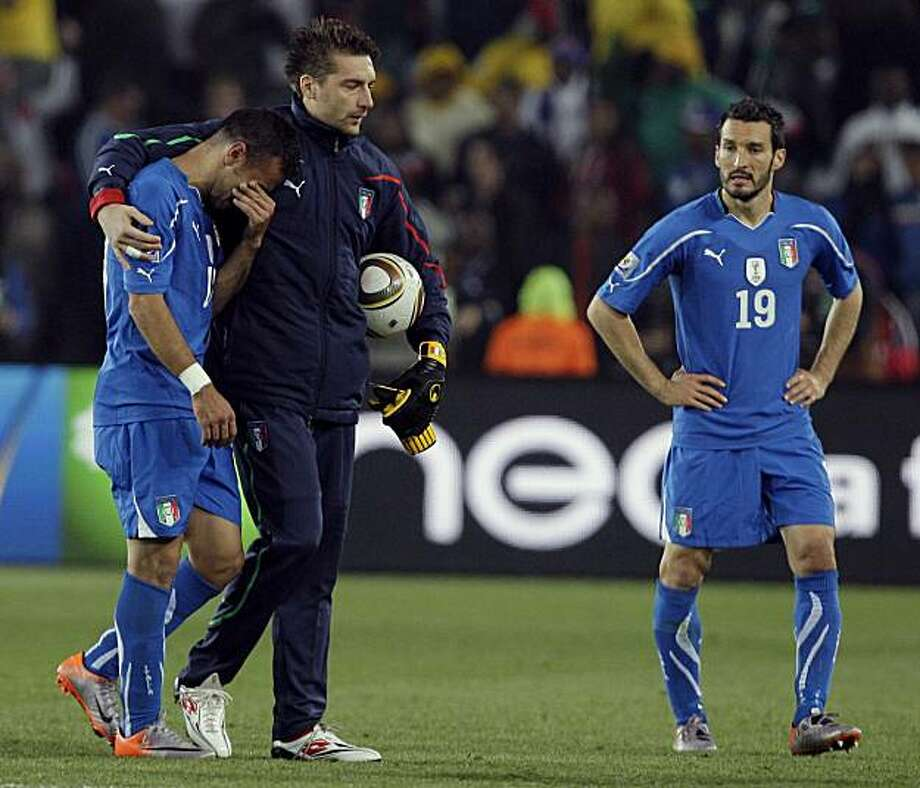 Italy's Fabio Quagliarella, left, cries as Italy's Gianluca Zambrotta, right, looks on at the end of the during the World Cup group F soccer match between Slovakia and Italy at Ellis Park Stadium in Johannesburg, South Africa, Thursday, June 24, 2010. Slovakia won 3-2 and advances to the round of 16. Photo: Alessandra Tarantino, AP