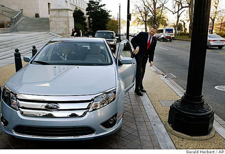 Ford and Volvo had 16 vehicles, including the Ford Fusion, in the 2009 model year on the Insurance Institute for Highway Safety?s list of the safest new carsFord Chief Executive Officer Alan Mulally arrives on Capitol Hill in Washington, Wednesday, Nov. 19, 2008, in a  new Ford Fusion Hybrid, a  car Ford says will best the fuel consumption of the Toyota Camry Hybrid. Mulally was on Capitol Hill  to testify before a House Financial Services Committee hearing on the automotive industry bailout.  (AP Photo/Gerald Herbert) Photo: Gerald Herbert, AP