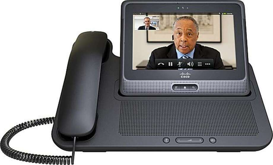 This undated product image provided Tuesday, June 29, 2010, by Cisco shows Cius, a tablet computer the company plans to release in 2011 with the ability to do video calls. The Cius stands in its docking station with handset. Photo: AP