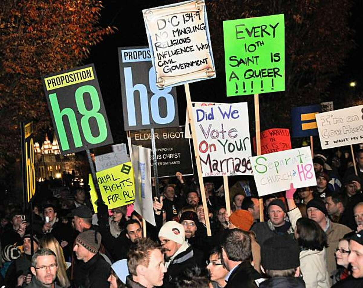 """In this Nov. 7, 2008 publicity image released by Red Flag Releasing, people gather to protest the Mormon church and their support of California's 2008 Proposition 8, a ballot initiative banning gay marriage, in Salt Lake City. The Mormon position on gaymarriage is the focus of the documentary """"8: The Mormon Proposition""""."""