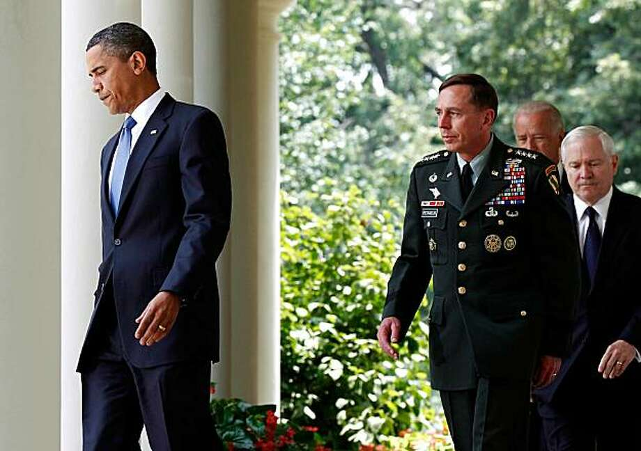 WASHINGTON - JUNE 23:  U.S. President Barack Obama walks with (L-R) Gen. David Petraeus, who will succeed Gen. Stanley McChrystal as commander of U.S. forces in Afghanistan; Vice President Joe Biden and U.S. Secretary of Defense Robert Gates, to make a statement in the Rose Garden of the White House June 23, 2010 in Washington, DC. Earlier in the day U.S. Army General Stanley McChrystal was relieved as top commander of the U.S. Forces in Afghanistan by Obama due to disparaging comments he made of membersof the Obama administration which were published in Rolling Stone magazine. Photo: Win McNamee, Getty Images