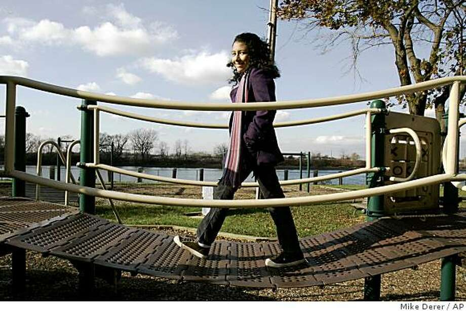 "Caitlin Sanchez, 12, of Fairview, N.J., poses in a park in Ridgefield Park, N.J., Thursday, Nov. 20, 2008. Sanchez is the new voice of ""Dora The Explorer,"" one of the world's most popular cartoons for preschoolers. (AP Photo/Mike Derer) Photo: Mike Derer, AP"