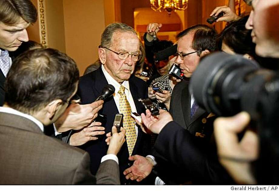 ** FILE ** In this Nov. 18, 2008 file photo, Sen. Ted Stevens, R-Alaska, is pursued by members of the media on Capitol Hill in Washington after attending a Republican Caucus . (AP Photo/Gerald Herbert, File) Photo: Gerald Herbert, AP