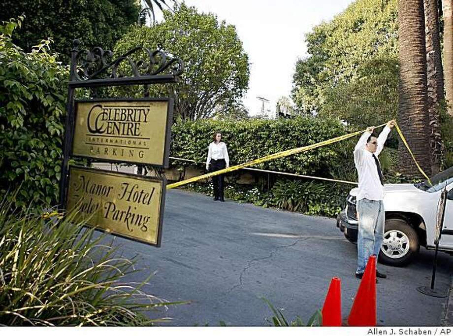 People control the area as Los Angeles Police Dept. investigate the shooting scene Sunday, Nov. 23, 2008, in the Hollywood section of Los Angeles. A security guard shot and killed a man wielding a sword Sunday on the grounds of this Scientology building, police said.  (AP Photo/Los Angeles Times, Allen J. Schaben) ** NO SALES, NO FOREIGN, NO MAGS, NO TELEVISION* LOS ANGELES DAILY NEWS OUT, ORANGE COUNTY REGISTER OUT, VENTURA COUNTY STAR OUT, INLAND VALLEY DAILY BULLETIN OUT, SAN BERNARDINO SUN OUT, LA OPINION OUT, MANDATORY CREDIT ** Photo: Allen J. Schaben, AP