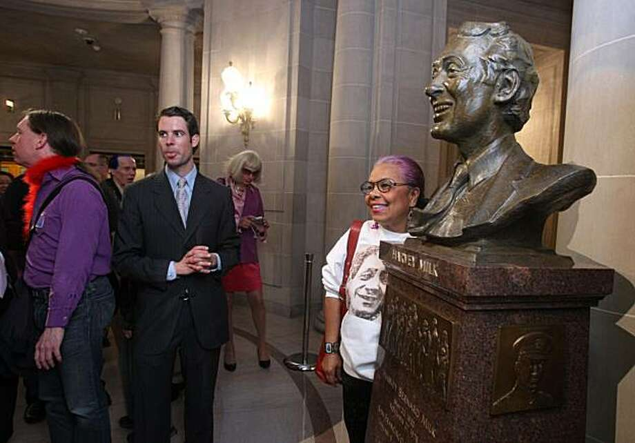 Lucrecia Fontes stands next to Harvey Milk's bust after it's unveiling at City Hall in San Francisco, Calif., on Thursday, May 22, 2008. Photo by Liz Hafalia / The Chronicle Photo: Liz Hafalia, The Chronicle