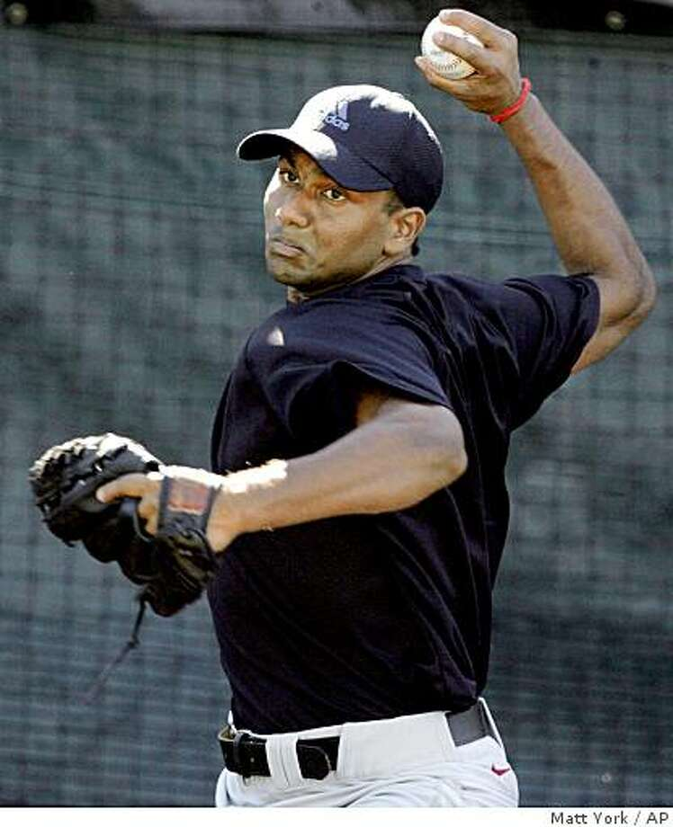 ** FILE ** In this Nov. 6, 2008  file photo, Dinesh Patel, 19, of India, throws during a baseball workout in Tempe, Ariz. Patel is one of two winners of the Million Dollar Arm contest held in India to find the best baseball throwing arms in India. The Pittsburgh Pirates hope Rinku Singh and Dinesh Patel really do have million-dollar arms. The two 20-year-old pitchers, neither of whom had picked up a baseball until earlier this year, signed free-agent contracts Monday, Nov. 24, 2008 with the Pirates. They are believed to be the first athletes from India to sign professional sports contracts outside their country. (AP Photo/Matt York, File) Photo: Matt York, AP