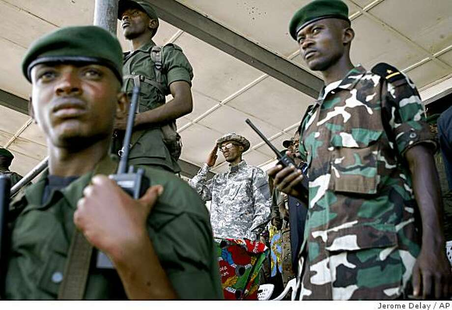 National Congress for the Defense of the People (CNDP) rebel leader Laurent Nkunda, center, is seen during a public rally in Rutshuru, 70 kilometers (43 miles) north of Goma, eastern Congo, Saturday, Nov. 22, 2008. (AP Photo/Jerome Delay) Photo: Jerome Delay, AP
