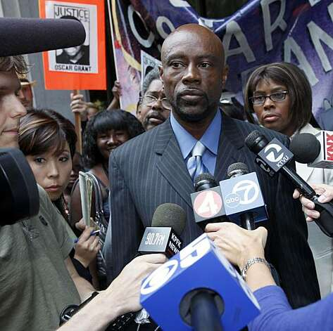 Cephus Johnson, uncle of shooting victim, Oscar Grant, and Grant's mother, Wanda Johnson, back right, speak to the media outside court during the trial of Johannes Mahserle, a former transit officer charged with killing Oscar Grant, Friday June 25, 2010 in Los Angeles. Mehserle testified Friday that he mistakenly pulled out his pistol instead of a stun gun when he shot and killed an unarmed black man who was lying face down on an Oakland train platform last year. Photo: Nick Ut, AP