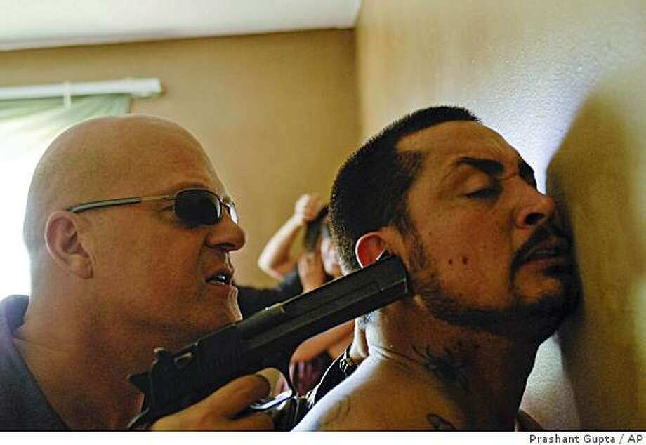 "In this image released by FX, Michael Chiklis as Det. Vic Mackey, left, is shown in a scene from the series finale of ""The Shield,"" airing Tuesday Nov. 25, 2008, at 10:00 p.m. EDT. Photo: Prashant Gupta, AP"