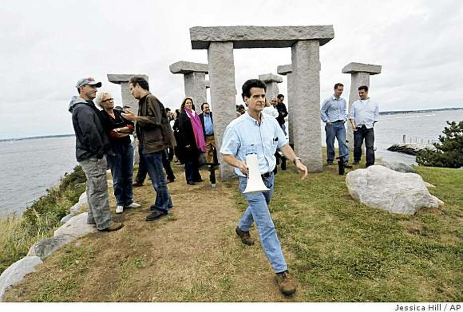 "Dean Kamen, center, walks from his replica of Stonehenge after finishing a talk with a group of corporate sponsors on North Dumpling Island, off the coast of Connecticut,  Friday, Sept., 12, 2008.   Kamen granted ""visas"" to a select group to brainstorm about his plans for the island and how it could be used to raise awareness and money for his robotic competition. (AP Photo/Jessica Hill) Photo: Jessica Hill, AP"