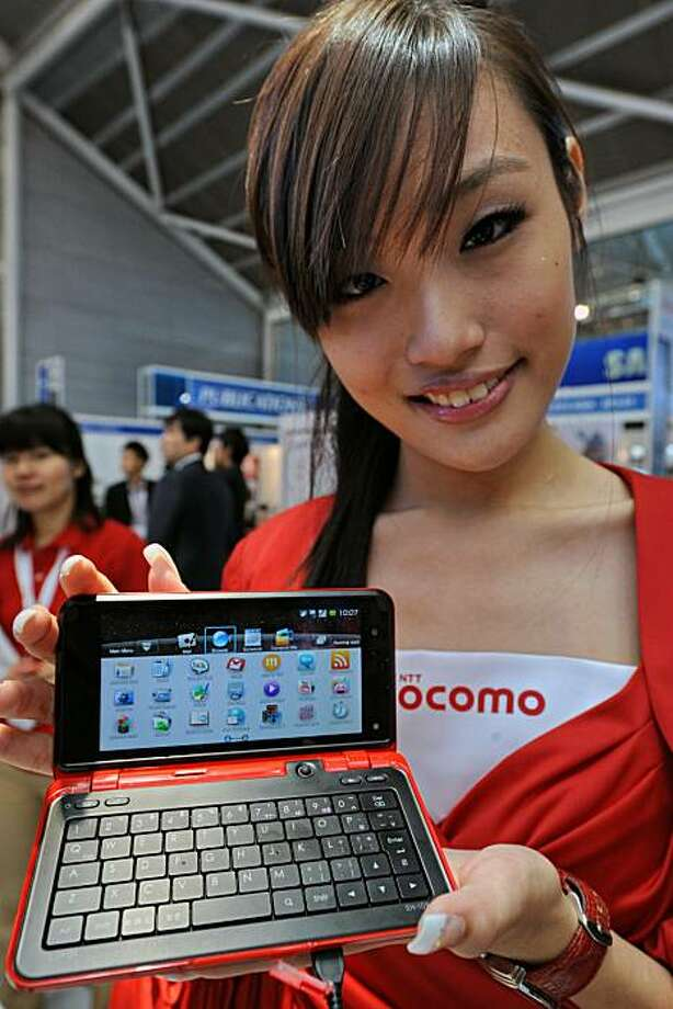 A promoter displays DoCoMo's LYNX SH-10B cellphone at CommunicAsia conference and exhibition in Singapore on June 15, 2010.  The Lynx Sh-10B 5.0 megapixels runs on Android operative system. Photo: Roslan Rahman, AFP/Getty Images