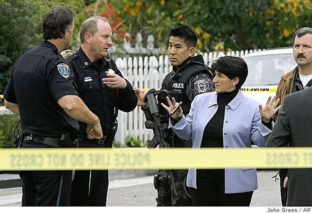 San Mateo Police Chief Susan Manheimer, right) talks with investigators near the scene of a shooting Tuesday, Nov. 25, 2008, on Hobart Avenue in San Mateo, Calif. Two people are dead after a shootout between police and an armed suspect at a San Mateo home.  Authorities say a SWAT team went to the house Tuesday morning after a man called to report that an armed robber had entered the residence with his wife and two children inside.  (AP Photo/San Mateo County Times, John Green) Photo: John Green, AP