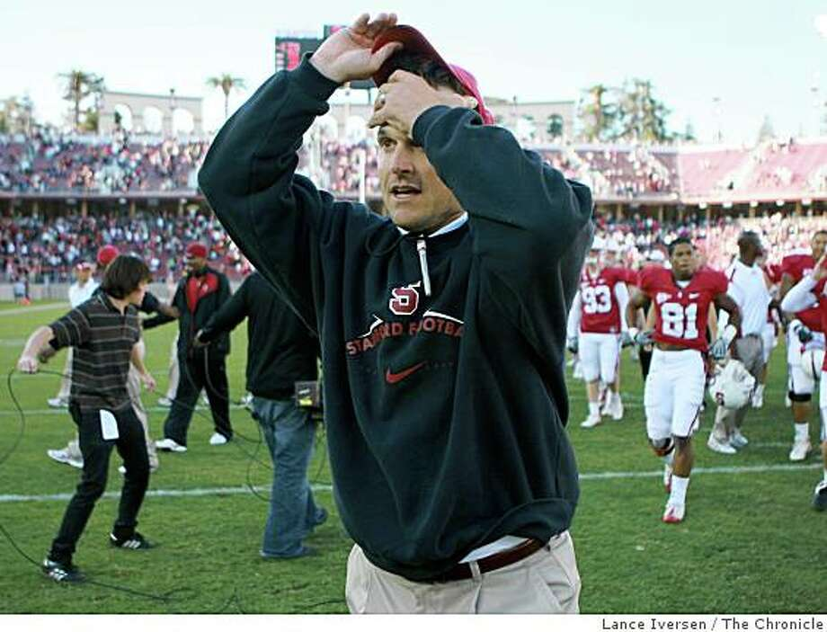 Stanford head coach Jim Harbaugh walks off the field after Stanford defeated Arizona Saturday 24-23, October 11, 2008 Photo: Lance Iversen, The Chronicle