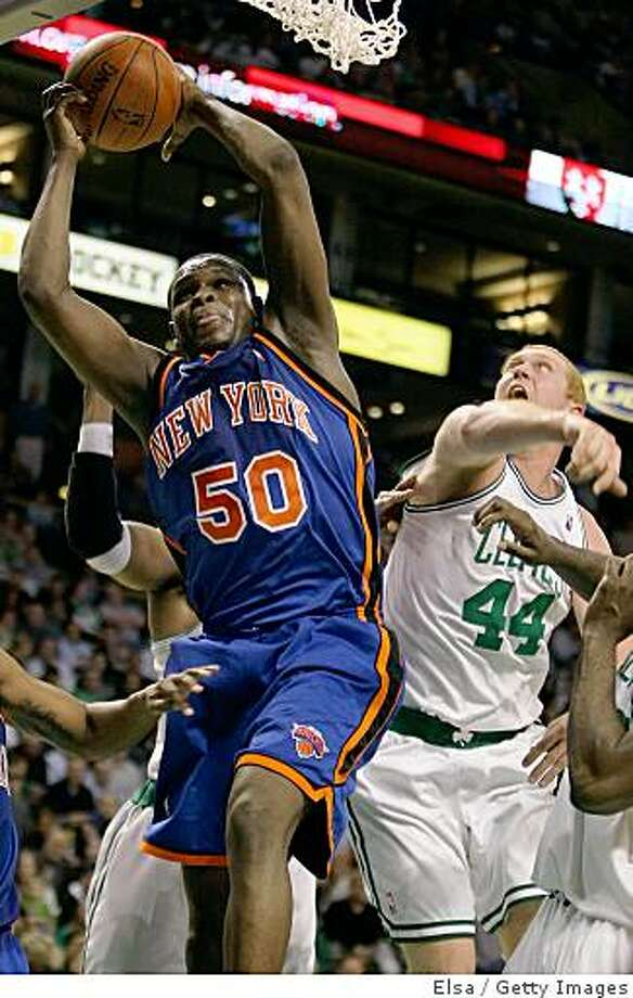 BOSTON - NOVEMBER 18:  Zach Randolph #50 of the New York Knicks grabs the rebound before Brian Scalabrine #44 of the Boston Celtics on November 18,  2008 at TD Banknorth Garden in Boston, Massachusetts. The Celtics defeated the Knicks 110-101. NOTE TO USER: User expressly acknowledges and agrees that, by downloading and or using this Photograph, user is consenting to the terms and conditions of the Getty Images License Agreement.  (Photo by Elsa/Getty Images) Photo: Elsa, Getty Images