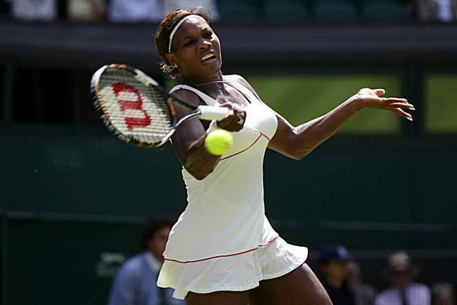LONDON, ENGLAND - JUNE 22:  Serena Williams of USA plays a shot during the first round match against Michelle Larcher De Brito of Portugal on Day Two of the Wimbledon Lawn Tennis Championships at the All England Lawn Tennis and Croquet Club on June 22, 2010 in London, England. Photo: Clive Brunskill, Getty Images
