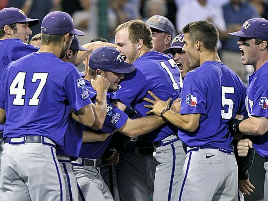 TCU players mob Matt Curry (17) after he hit the go-ahead grand slam against Florida State in the eighth inning of an NCAA College World Series baseball elimination game in Omaha, Neb., Wednesday, June 23, 2010. Photo: Ted Kirk, AP
