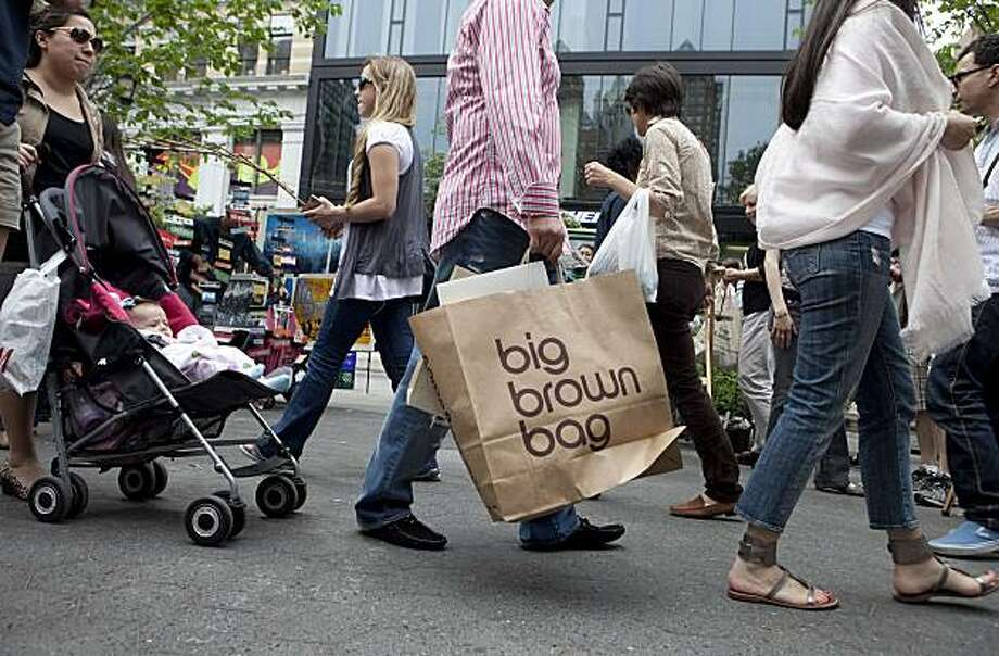 A man carries a Bloomingdale's bag as he walks through Union Square in New York, U.S., on Friday, May 28, 2010. Consumer spending in the U.S. unexpectedly stalled in April as Americans used growing wages to rebuild savings. Photographer: Daniel Acker/Bloomberg Photo: Daniel Acker, Bloomberg News
