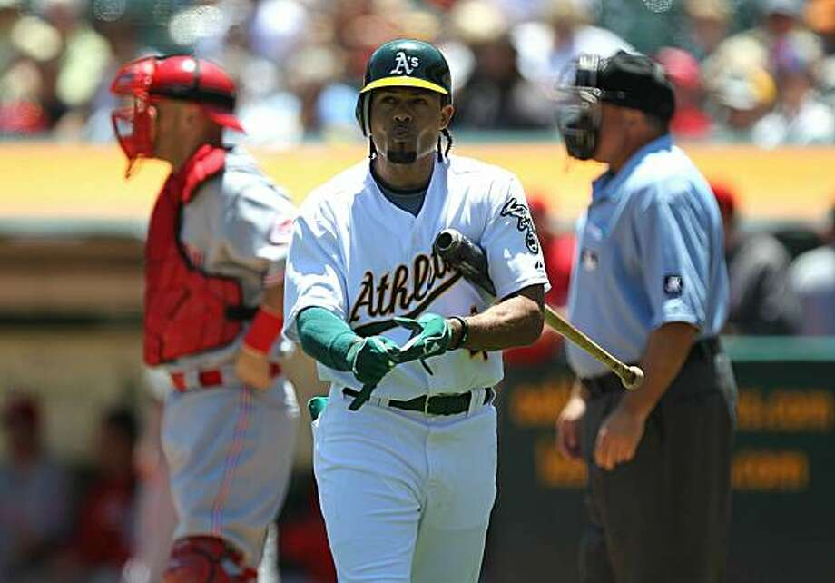 OAKLAND, CA - JUNE 23:  Coco Crisp #4 of the Oakland Athletics strikes out against the Cincinnati Reds in the first inning during an MLB game at the Oakland-Alameda County Coliseum on June 23, 2010 in Oakland, California. Photo: Jed Jacobsohn, Getty Images