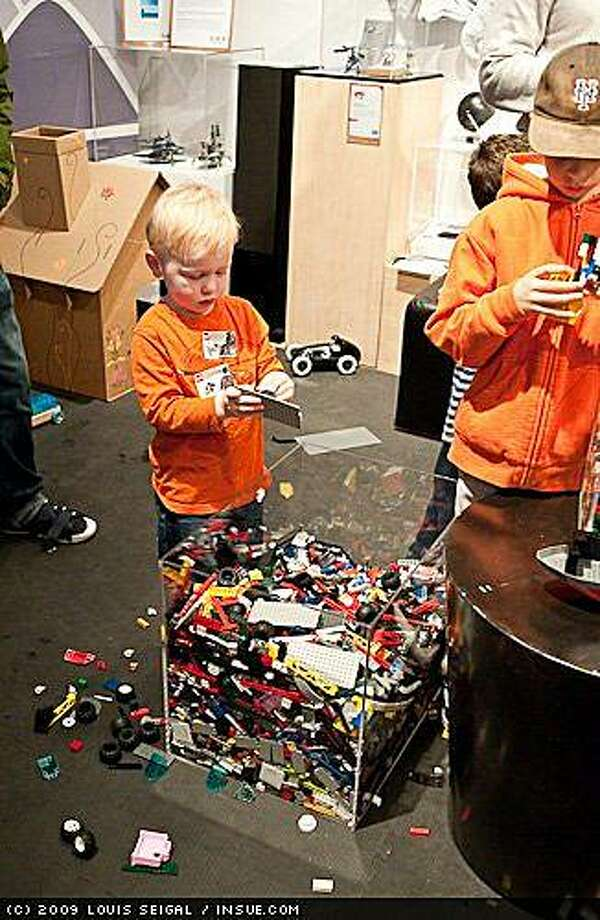 Children will have 2 minutes to attach 30 Lego bricks to the sides of remote-control cars for a demolition derby during Saturday's Geek Dad event. Photo: Louis Seigal