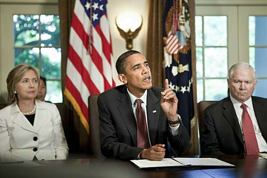 WASHINGTON - JUNE 22:  (AFP OUT) Secretary of State Hillary Rodham Clinton (L) and Secretary of Defense Robert M. Gates (R) listen as President Barack Obama speaks to the press after a meeting in the Cabinet Room of the White House June 22, 2010 in Washington DC.  President Obama spoke about the war on terrorism, the Gulf of Mexico Oil spill and Gen. Stanley A. McChrystal's comments about the administration in a Rolling Stone. Photo: Pool, Getty Images