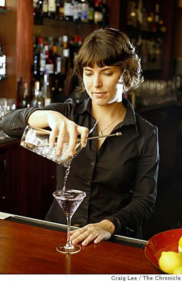 """Jackie Patterson making her cocktail drink she created  called """"The Violet Hour"""" at Zinnia restaurant in San Francisco, Calif., on November 14, 2008. Photo: Craig Lee, The Chronicle"""