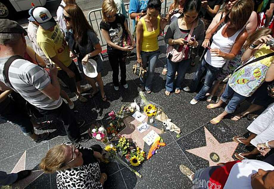 Fans pay their respects at the star of Michael Jackson on the Hollywood Walk of Fame on the first anniversary of the pop star's death Friday, June 25, 2010. Photo: Reed Saxon, AP