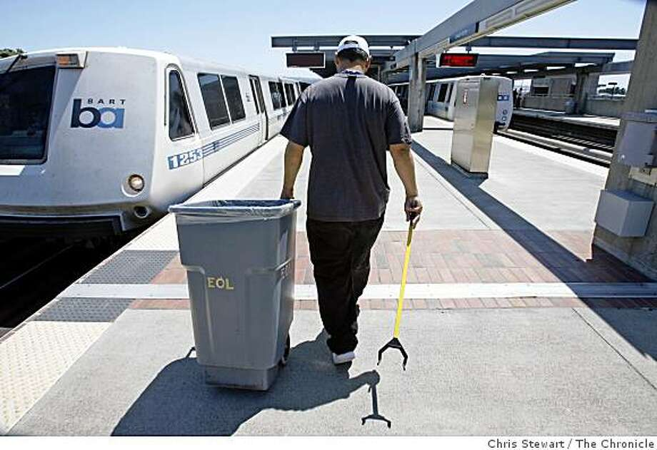 End of line employee Mike Coniglio, 36, awaits the arrival of a BART train before a mad dash to clean it at the Daly City BART station. Photographed June 16, 2007. Photo: Chris Stewart, The Chronicle