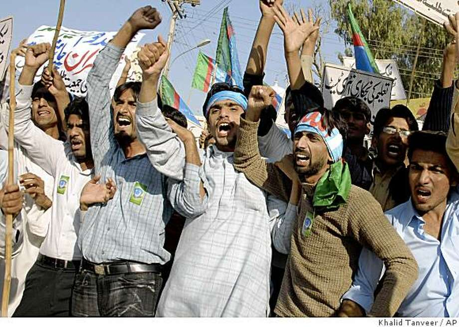 Pakistani students chant slogans against U.S. at a rally to condemn a suspected American missile strike at Taliban and militants' hideouts in Pakistani tribal areas along Afghanistan in Multan, Pakistan, on Thursday, Nov. 20, 2008. Pakistan summoned the U.S. ambassador Thursday to protest a suspected American missile strike deep inside its territory as militants threatened revenge attacks unless the cross-border raids stop. (AP Photo/Khalid Tanveer) Photo: Khalid Tanveer, AP