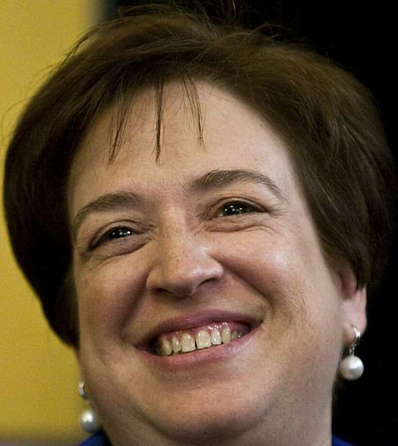 """In this May 26, 2010, photo, Supreme Court nominee Elena Kagan smiles on Capitol Hill in Washington, before her meeting with Jeff Merkley, D-Ore. Kagan's review of the book """"A Confirmation Mess"""" is creating a confirmation mess of its own. Kagan's 1995 commentary on Stephen Carter's book rendered a harsh judgment on how lawmakers question Supreme Court nominees, and that has some senators preparing to interrogate her about it. Photo: Drew Angerer, AP"""