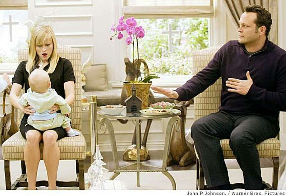 This photo released by Warner Bros. Pictures shows Reese Witherspoon as  Kate and  Vince Vaughn as Brad  as they  discover the pitfalls of holding a baby in New Line Cinema's romantic comedy, Four Christmases. Photo: John P Johnson,, Warner Bros. Pictures