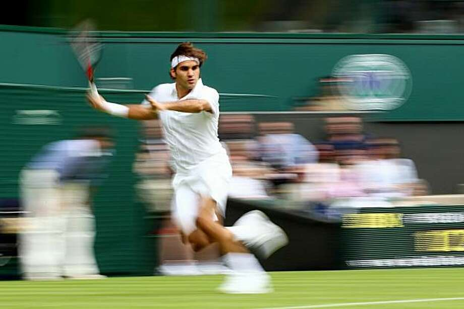 LONDON, ENGLAND - JUNE 21:  Roger Federer of Switzerland in action during his first round match against Alejandro Falla of Columbiaon Day One of the Wimbledon Lawn Tennis Championships at the All England Lawn Tennis and Croquet Club on June 21, 2010 in London, England. Photo: Julian Finney, Getty Images