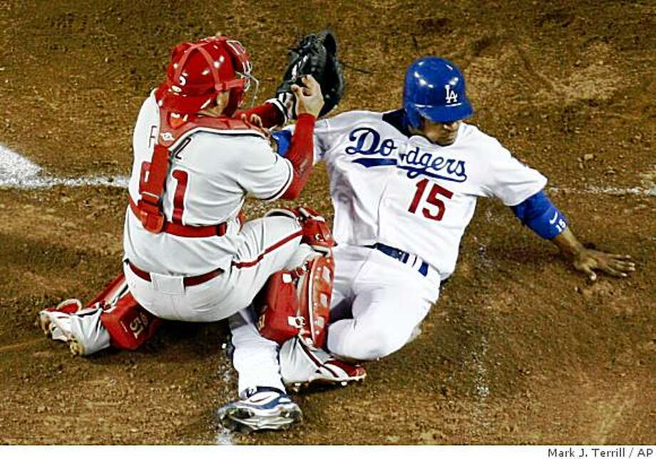 Los Angeles Dodgers' Rafael Furcal scores from Manny Ramirez's single to center against the Philadelphia Phillies's Carlos Ruiz during the 5th inning in Game 4 of the National League baseball championship series Monday, Oct. 13, 2008, in Los Angeles. (AP Photo/Mark J. Terrill) Photo: Mark J. Terrill, AP