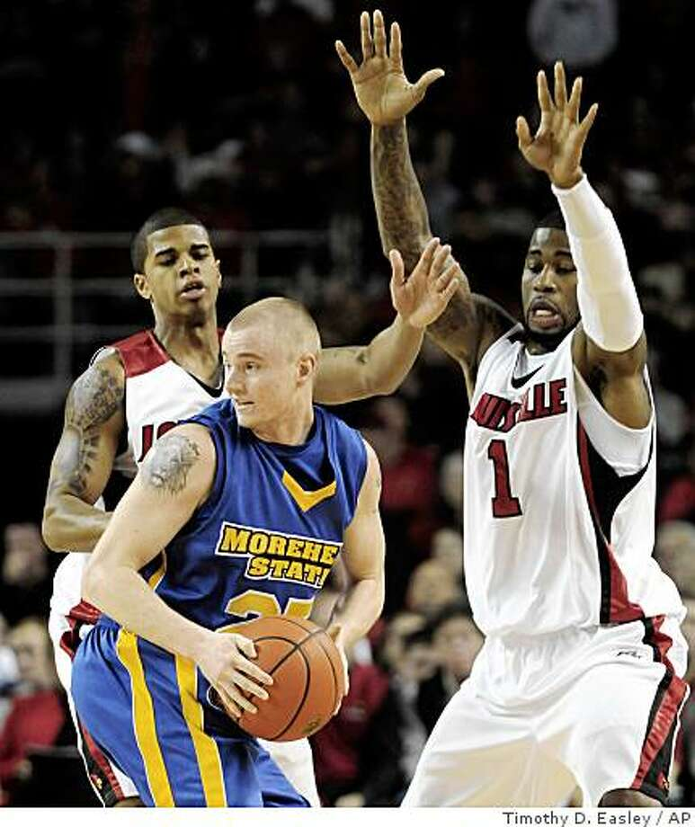 Morehead State's John Lamb, center, looks for help as Louisville's Edgar Sosa, left, and Terrence Williams apply pressure during the first half of an NCAA men's college basketball game Saturday Nov. 22, 2008 in Louisville, Ky. (AP Photo/Timothy D. Easley) Photo: Timothy D. Easley, AP