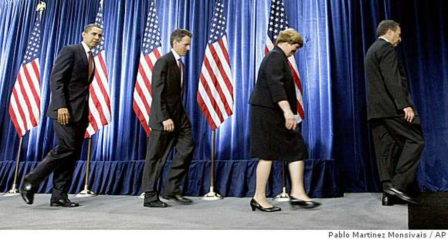 President-elect Barack Obama, left, walks out with members of his announced economic team following a news conference, Monday, Nov. 24, 2008, in Chicago. From left are, Obama, Treasury Secretary-designate Timothy Geithner, Council of Economic Advisers Chair-designate Christina Romer, National Economic Council Director-designate Lawrence Summers. (AP Photo/Pablo Martinez Monsivais) Photo: Pablo Martinez Monsivais, AP