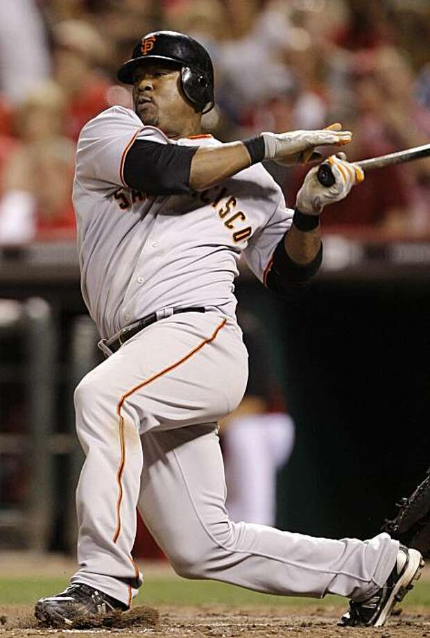 San Francisco Giants Juan Uribe hits a single off Cincinnati Reds relief pitcher Enerio Del Rosario to drive in two runs in the seventh inning of a baseball game, Monday, June 7, 2010, in Cincinnati. Uribe had four rbi's in the game won by San Francisco 6-5. Photo: Al Behrman, AP