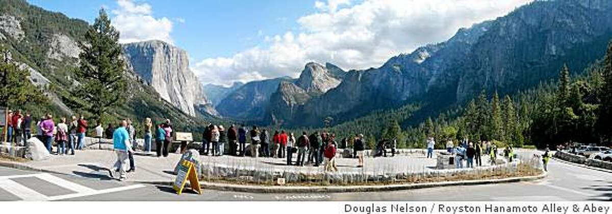 Tourists look out at Half Dome in Yosemite National Park at the newly redesigned Tunnel View Overlook on October 10, 2008. A half dozen trees were removed and a dedicated viewing area was built to give tourists easier access to the picturesque viewing spot.