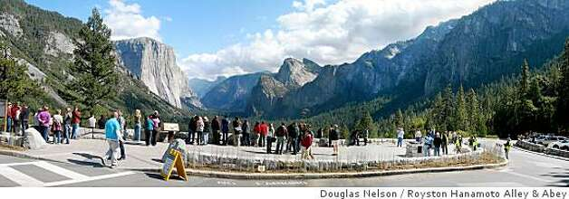 Tourists look out at Half Dome in Yosemite National Park at the newly redesigned Tunnel View Overlook on October 10, 2008. A half dozen trees were removed and a dedicated viewing area was built to give tourists easier access to the picturesque viewing spot. Photo: Douglas Nelson, Royston Hanamoto Alley & Abey