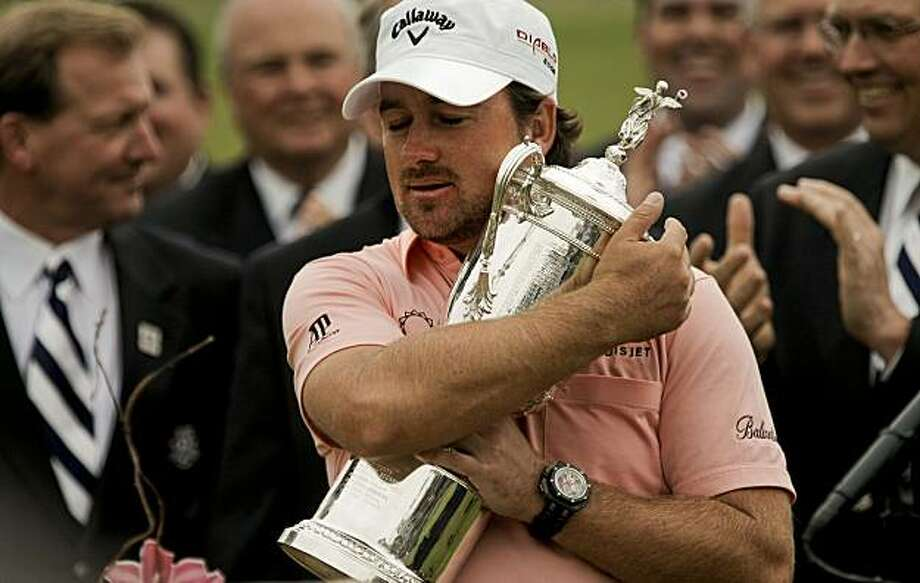 Gaeme McDowell clutches the U.S. Open trophy after his victory at Pebble Beach on Sunday. Photo: Michael Macor, The Chronicle