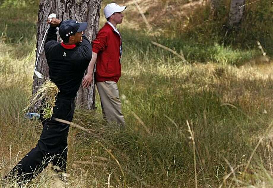 Tiger Woods escapes the tall grass after he hit his drive on the third hole into the woods during the final round of the 110th U.S. Open on Sunday at Pebble Beach. Photo: Lance Iversen, The Chronicle