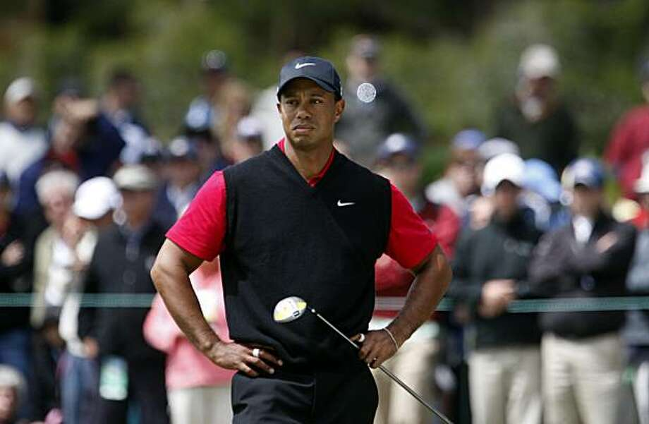 Tiger Woods takes a long look at the fifth green after missing a birdie attempt during final rounds of the 110th U.S. Open victory Sunday at Pebble Beach. Photo: Lance Iversen, The Chronicle