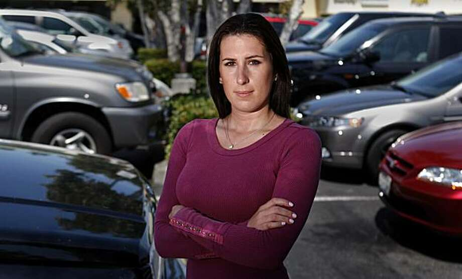 Sara King, 26, shown at her parents' insurance company in Encinitas, California, bought a Toyota Corolla recently for zero percent financing and then was told 10 days later the dealership was unable to find a bank to buy the loan. The dealer demanded a higher interest rate from her, and she ended up selling the car back to the dealership. (Allen J. Schaben/Los Angeles Times/MCT) Photo: Allen J. Schaben, MCT