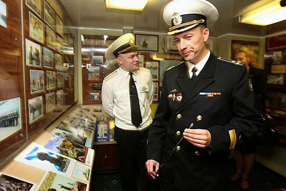 Capt. Eduard Muskalenko, the Varyag's commander, shows the ship's museum in San Francisco on Monday.