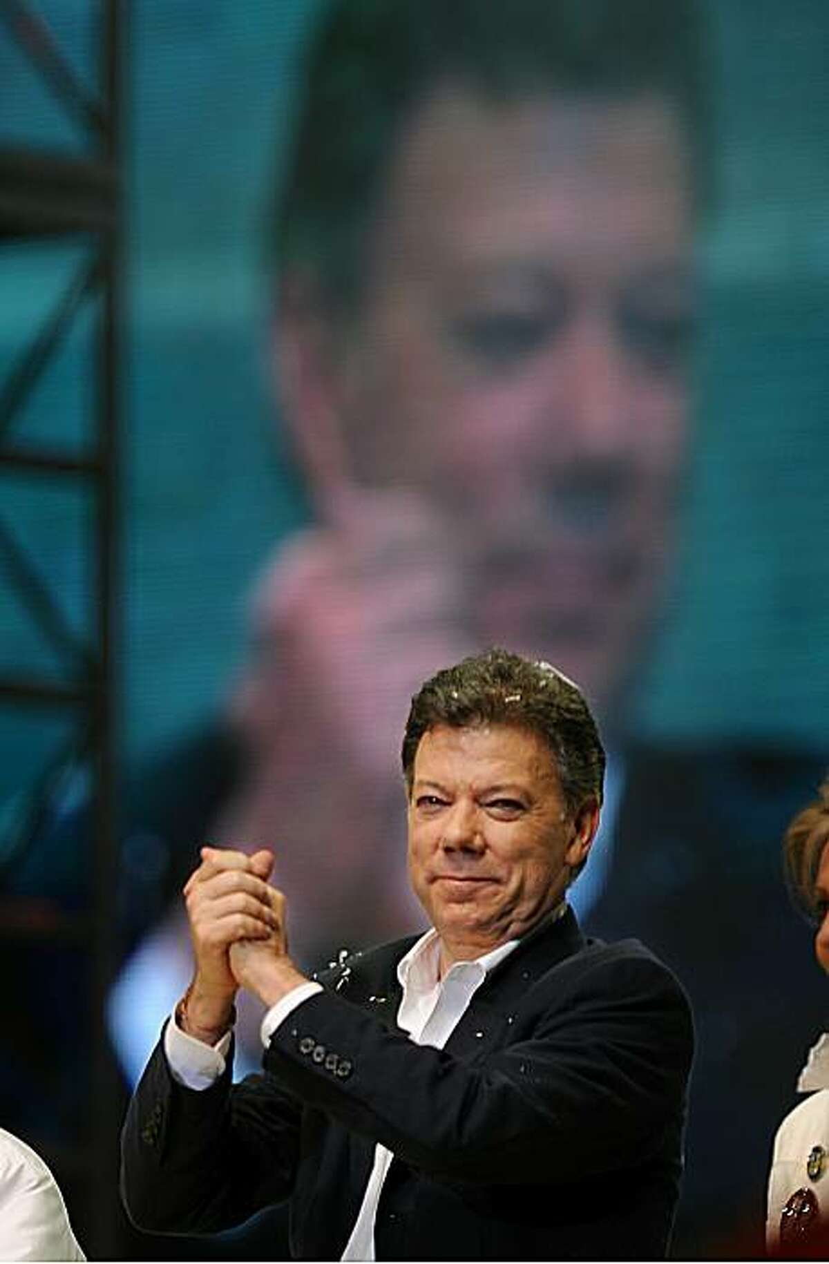 Colombian President elect Juan Manuel Santos gestures as he delivers a speech in Bogota on June 20, 2010, after the presidential election run-off. Conservative former Defense Minister Juan Manuel Santos won Colombia's presidential run-off vote Sunday taking 69.2 percent of the poll with 53.9 percent of votes counted, the National Electoral Board said. Santos, who will succeed popular two-term President Alvaro Uribe, defeated Green Party rival Antanas Mockus, a former Bogota Mayor who drew 27.4 percent ofthe vote, the board added.